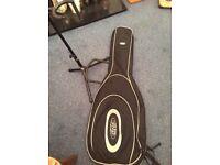 Bass guitar padded gig bag and stand.