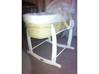 Moses basket and rocking stand plus extra