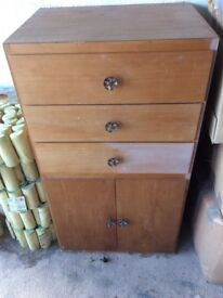 Wooden tall cabinet with drawers and cupboard