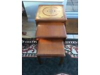Set of three coffee tables largest is tiled finished