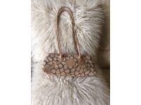 LIZ COX Designer handbag in woven fabric with leather shoulder straps.