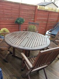 Garden furniture... dining table and four chairs