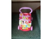 Vetch baby walker. Complete and working, V.g.c. Used by granddaughter occasionally £10.00