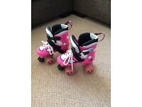 Pink roller boots