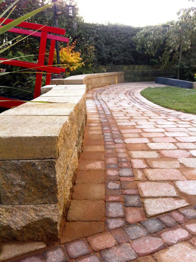 Sandstone coloured block walling