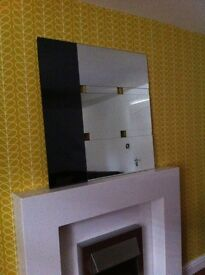 Housing units mirror 35 ins x 35 ins. Slight chips on two corners, not noticeable when on wall.