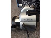 Konica Minolta Dimage Z3 12x digital zoom camera together with Lopro camera case