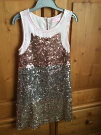 Girls dress age 8. Pink & silver sequinned dress heavy.
