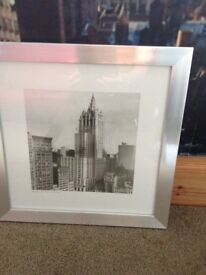 Pair of New York framed pictures