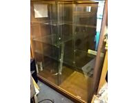 A Wooden & Glass Retail Display Cabinet with shelves & cable access point approx 5ft Ht & 4 Ft wide