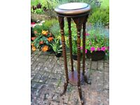Attractive wooden plant stand.
