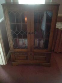 Small cabinet with leaded glass doors and drop-down front panel