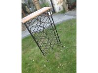 Old wine rack holds 22 bottles Wrought iron with wooden top