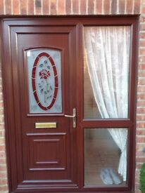 Brown wood grain upvc double glazed front door and outer casing