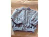New hand knitted blue wool baby cardigan, age 3-6 months