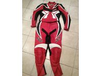 IXS ladies red leather motorbike suit size 8-10 with armour