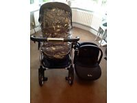 Excellent condition silver cross travel system