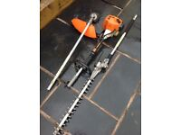 Stihl km85 petrol combi engine with long reach hedgecutter and strimmer attachments