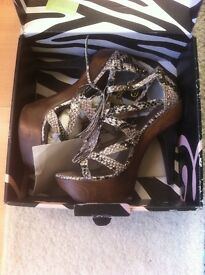 Shoes size 7 boots size 8 both brand new in original boxes