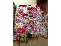 A massive bundle of baby girl clothes aged 9-12 months
