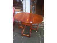 Drop Leaf table with barley twist legs , nice oval shape when up.