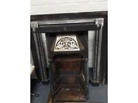 Cast iron fireplace and chimney