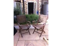 Pair of wooden garden chairs