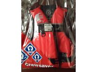 life/buoyancy jacket.Crewsaver. Medium adult 40kg.Red/Black used only once.Dry stored