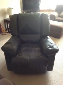 Dark green recliner leather chair.