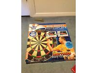 Darts board with darts, not used in box