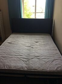 Black leather effect double bed with mattress in good condition , collection only