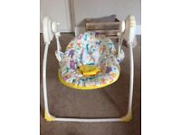 Kiddicare baby swinging chair. Battery operated. Plays music. Folds down for easy storage.