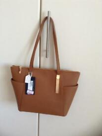 Tan coloured handbag with gold colour trim. Brand new with tags on.