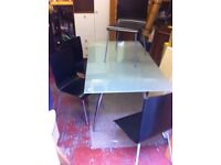 Modern glass top dining table & four chairs