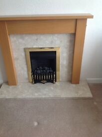 Gas fire with oak surround and marble hearth