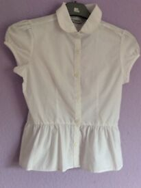 35% cotton 65% polyester girls white blouse short sleeves. Selling for BDFA charity no 1084908.