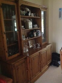 Large pine dresser with glass panel doors