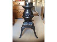 Vintage cast iron pot bellied stove