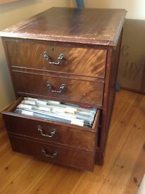 Wooden filing cabnet with lots of file holders and some labels see pictures
