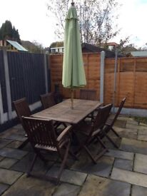 Wooden table with 6 chairs, umbrella and stand