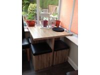 Compact dining table with 4 storage cushioned seats