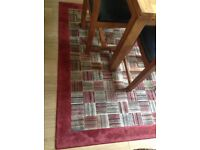 Red multi coloured large rug