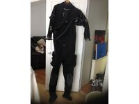 Scuba pro dry suite . Used 4 times in the lake . Open to sensible offers