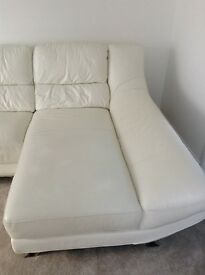 Leather sofa and matching swivel chair