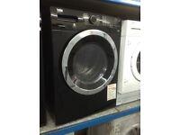 Beko black freestanding 8/5 washer dryer. £349. New/graded. 12 month Gtee