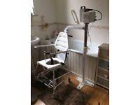 Bath hoist and chair.