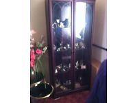 Display Cabinet Large Dark wood with full height patterned glass doors. £45 .
