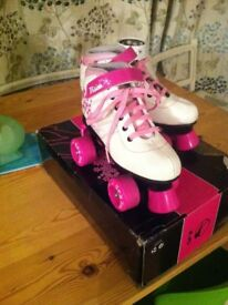 girls pink and white SFR roller skates size 2 immaculate condition