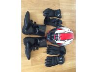Motorcycle crash helmet, boots and gloves