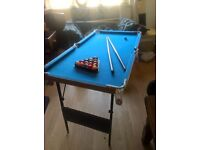 pool table with cues